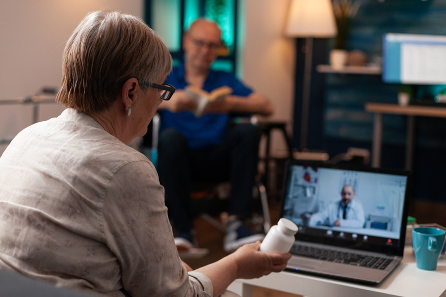 NEW---caucasian-old-woman-using-online-conference-video--X8P288K