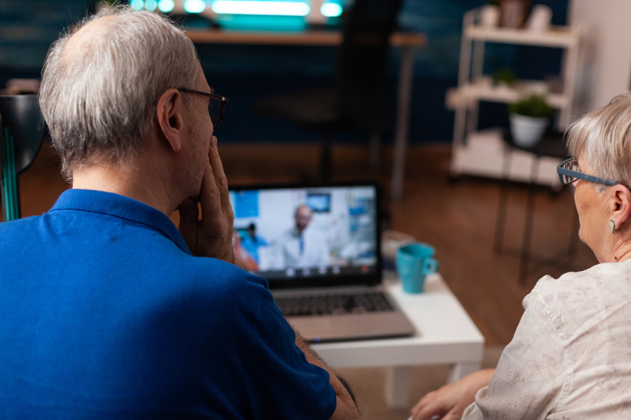 NEW---elderly-couple-using-video-call-for-dentist-advice-8WWY7PQ
