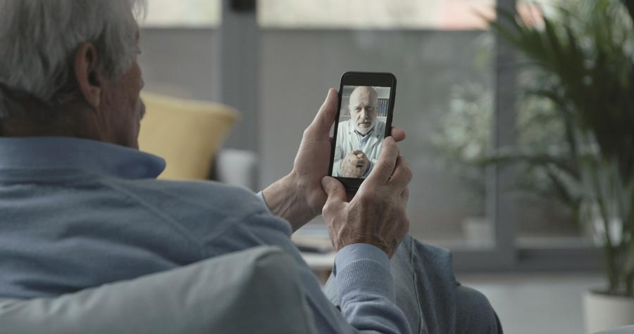 NEW---elderly-man-video-calling-his-doctor-KKL5WJ4